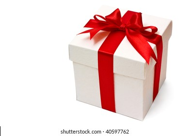 white gift box with a red ribbon and bow isolated over white