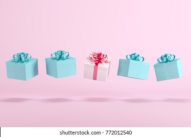 White gift box with red ribbon among blue gift box floating on pink background. minimal christmas concept idea.