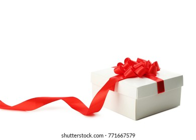 White gift box with ribbon isolated on white