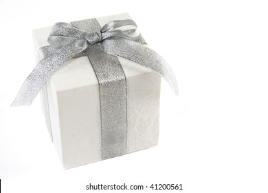 white gift box with silver bow and ribbon isolated over white