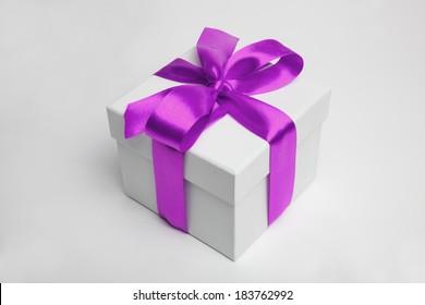 white gift box and violet ribbon