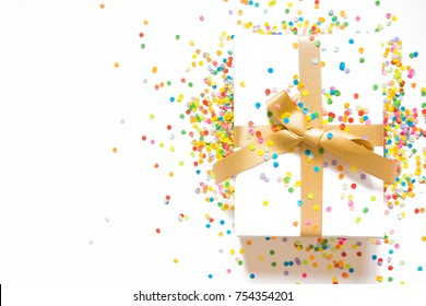 White gift boxes with gold ribbons. White background. Gift for Christmas or a birthday.