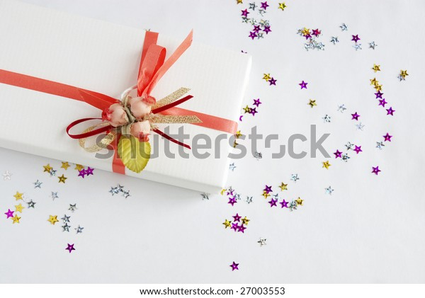 white gift with pink decoration and sparkles