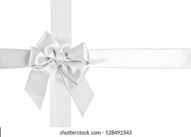 White gift ribbon and bow isolated on the white background