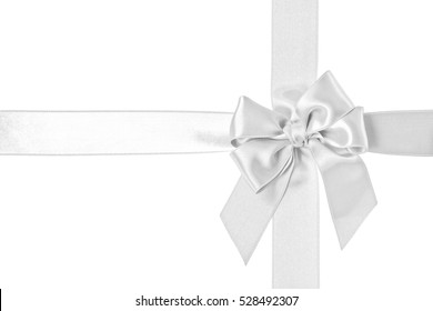White gift satin ribbon and bow isolated on the white background