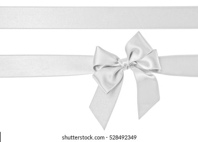White gift silk ribbon and bow isolated on the white background