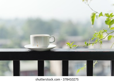 The white glass with stain on the balcony with sunlight in the spring morning