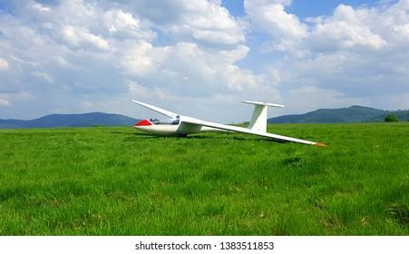 White glider. Sailplane on aeroclub airport.