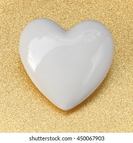 White glossy porcelain heart on golden glittery background; Golden Wedding; Wedding invitation card; Love note