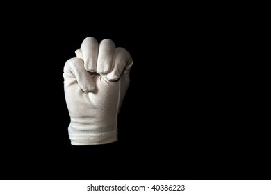 A white gloved hand isolated on black background. American sign language alphabet M.