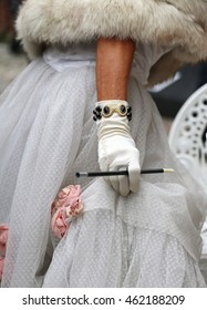 white glovers of an elegant lady with the cigarette holder