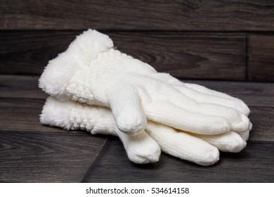 White gloves on wooden background