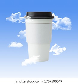 White To Go Paper Coffee Cup with Black Lid with Clouds and a Blue Sky Background