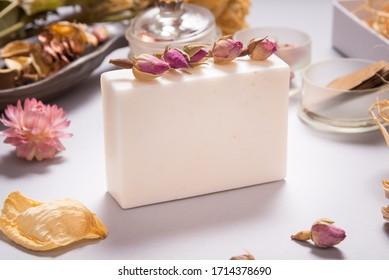 White goat milk handmade soap on grey background