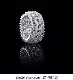 White gold diamond ring on black background