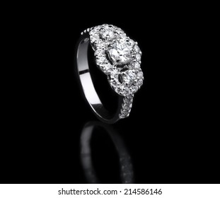 White gold diamond ring standing position on black background