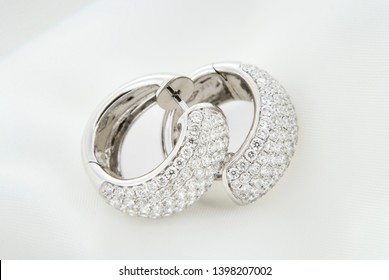 White Gold Earrings With Diamonds On Soft White Background