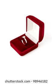 White gold engagement ring in gift box on white background