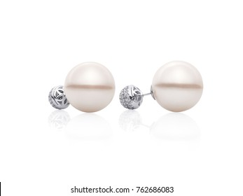 White gold small earrings with pearls on white background, jewelry