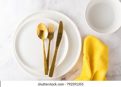 White and gold table setting a new style with napkin