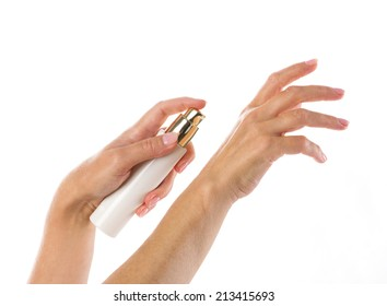 white and gold  tube in hands of senior woman isolated on white
