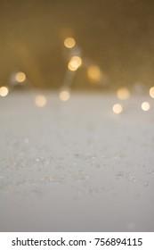 white and golden glittering bokeh background for christmas