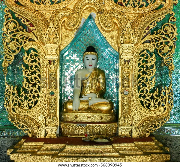 white and golden marble buddha statue in myanmar