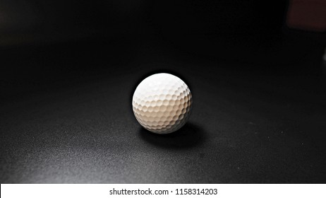 White golf ball isolated on black background. Golf ball texture and background.