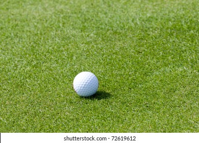 White golf ball on fresh green