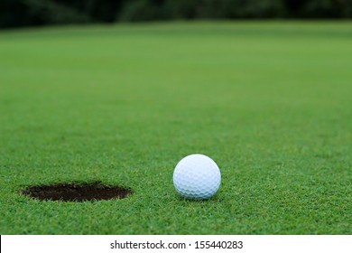 White golf ball on putting green
