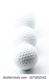 White golf balls on the white background