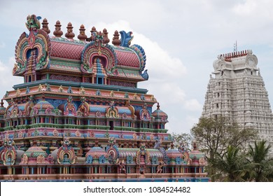 The white Gopuram, or gateway, known as the Vellai gopuram symbolizing purity, in the Sri Ranganatha Swamy temple complex at Trichy, India, stands in sharp contrast to its other vividly painted towers