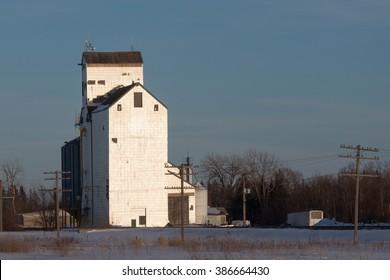 White Grain Elevator at Sunset in Winter