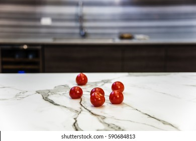 white granite kitchen counter with red tomatoes on it