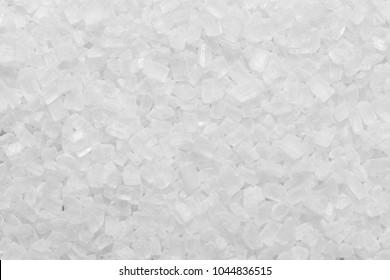 white granulated sugar texture or salt granule background