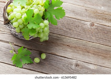 White grape in basket on wooden table. View with copy space for your text