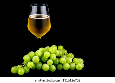 White grapes and glass of wine isolated on a black background