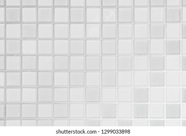 White or gray ceramic wall and floor tile abstract background. Design geometric mosaic texture for the decoration of the bedroom. Simple seamless pattern for backdrop advertising banner poster or web