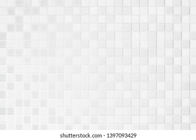 White or gray ceramic wall and floor tiles abstract background. Design geometric mosaic texture for the decoration of the bedroom. Simple seamless pattern for backdrop advertising banner poster or web