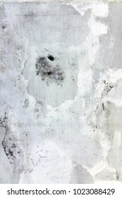 White and Gray Dirty Plaster Wall, With Falling Off Flakes Of Paint. Rough Surface. Old Weathered Painted Grey Background Texture. Vintage Timber Background. Peeled Plaster Brickwall
