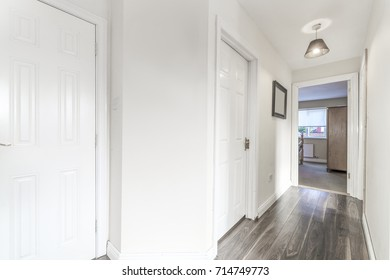 White and gray hallway in a house