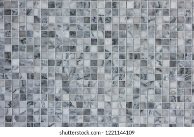 White and gray marble wall tiles for textured background. Modern or antique house interior