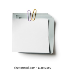 White and gray note papers with paperclip on white background