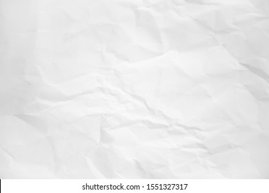 white and gray wide crumpled paper texture background. crush paper so that it becomes creased and wrinkled.