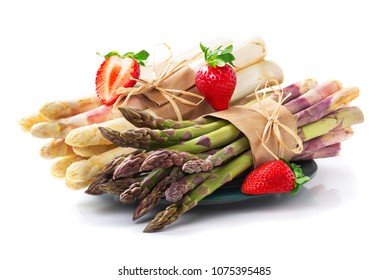 White and green asparagus and strawberries, isolated