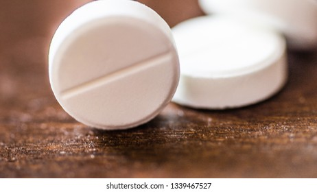 White, green, pink, orange capsules pill spilled out from white plastic bottle container. Global healthcare concept. Antibiotics drug resistance. Antimicrobial capsule pills and thermometer. Pharmace