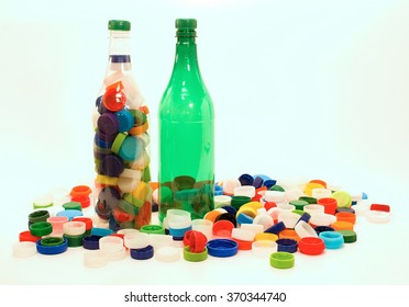 White and green plastic bottles with caps