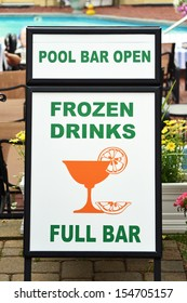 A white and green sign advertising a pool bar