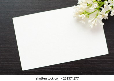 white greeting card with flowers on a black background
