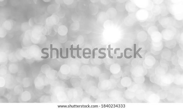 white grey glittering, glowing light for twinkling banner background, bokeh glitter blink in night blurred background, glittering white gray background
